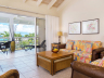 Living-room-and-screened-porch-in-733-at-ocean-club-west-resort-on-grace-bay-beach