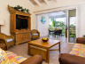 Living-room-and-screened-porch-in-733-at-ocean-club-west-resort-providenciales