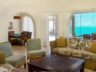 breezy-villa-long-bay-oceanfront-villa-for-sale-providenciales-turks-and-caicos-dining-room-with-ocean-view-2