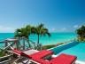 Oceanside Tower villa-silly creek- oceanfront-4 bedroom-view of infinity pool-ocean